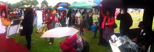 The audience for the combined choirs of St John's and Fair Field schools in Radlett in the rain at the 2011 Radlett Festival